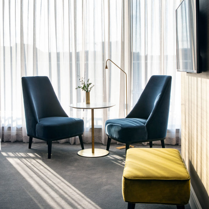 Two blue chairs in a hotel room in Ghent